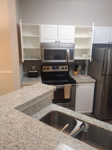 Kitchen Features Granite Countertops and Ample Storage