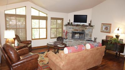 Living Room with wood burning fireplace and views of the creek
