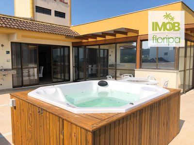 Photo for Coverage with Jacuzzi and a view of the sea in front of the Acqua!