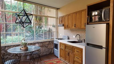 Sunny garden level beautifully appointed NEW kitchen with high end appliances.