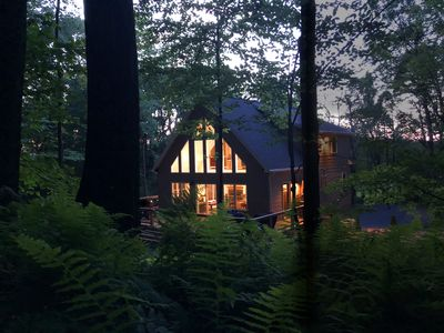 Nestled deep in the woods means total tranquility.  Relax on the over sized deck