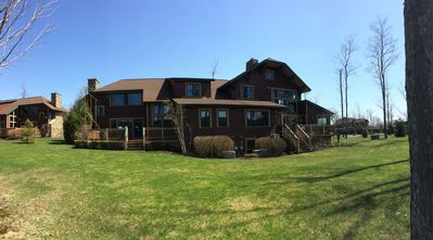 Spring time view of the Clubhome unit from the back yard (9th fairway).