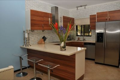 Well appointed modern kitchen, upgraded with quartz counter tops
