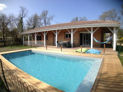 Photo for Wood house, private heated pool with fence, close to the beach, WIFI
