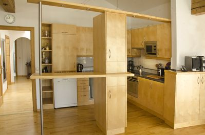 Open plan living & dining area  with  equipped  kitchen, & hallway to bedrooms