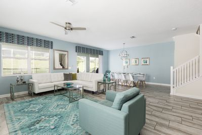 living room view along with footsteps to upstairs of the championsGate homes