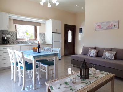 Photo for Elegant, bright residense w/ ample garden, steps from sandy beach & Chania town