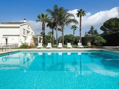 Photo for 5 bedroom Villa, sleeps 12 with Pool, Air Con, FREE WiFi and Walk to Shops