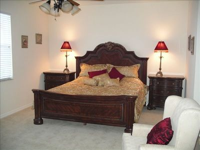 King size master suite with tub, walk in shower and twin walk in closets