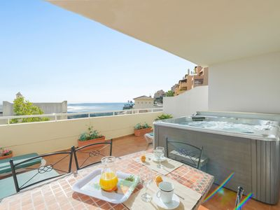 Photo for Sun, sea and Golf! Gorgeous apartment with private jacussi and view of the sea.