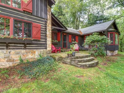 Photo for Dog-friendly, lakefront log home on a quiet cove - front deck & shared dock