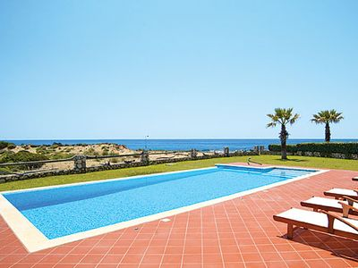 Photo for Sea front villa w/ 3 bedrooms, gardens, PlayStation 3, Wi-Fi & A/C