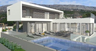 Photo for Luxurious holiday villa with heated swimming pool and spa zone