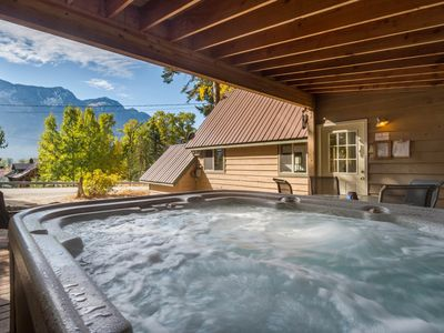 Photo for Gorgeous chalet with forest views. Comes with a private hot tub!