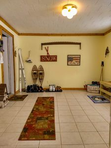 You enter into a spacious mud room where you can leave your gear.