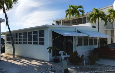 Photo for Charming Canal Front Cottage 35 foot dock just minutes to Key West