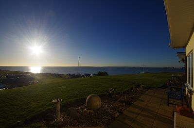 view across the front garden and terrace looking west to the IOW