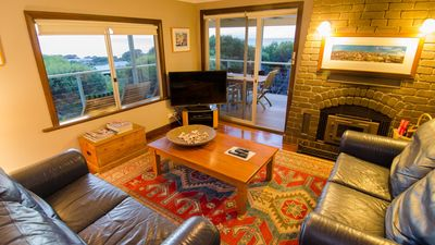 Open living area and lounge with fireplace. Opens onto outside deck and seating