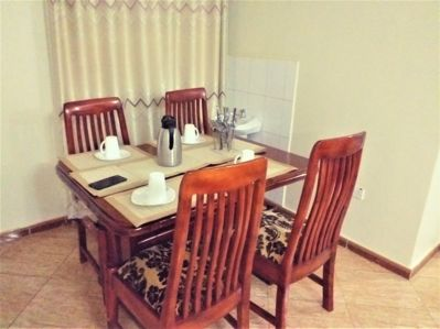 Dining table with power outlet for computer