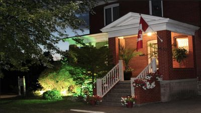 Photo for Beautiful Heritage House with private hot tub, private yard, walk to the fall