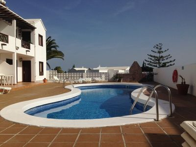 Photo for Top floor one bedroom apartment with free wifi, communal pool and sea views