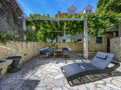 Photo for Charming house with beautiful large garden inside ancient city walls