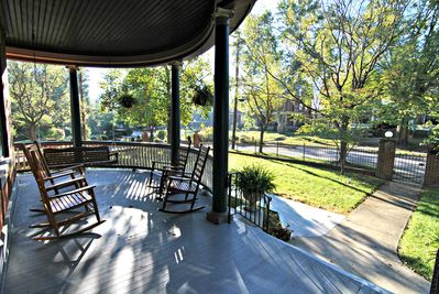 Large front sitting porch with swing and rockers