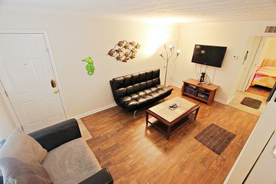 Walk in to the welcoming living room. Also sleep 2 guests on the fold down couch.