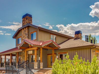 Photo for Beautifully furnished home with private hot tub and community pool/fitness room!