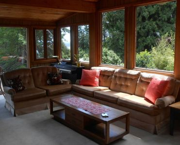 Summer fun playing the piano in the sunroom with vaulted ceilings and skylight.