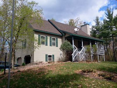 Photo for HOME ON A HILL, ACROSS FROM LAKE, PIER, 6 WOODED ACRES, 2 DECKS, FAMILY FRIENDLY