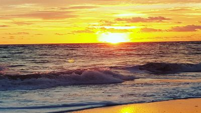 sit on the beach and watch the sun rise