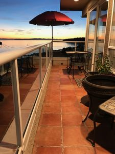 Photo for Stunning Ocean Views and Sunsets. Beach and shopping just a 5 minutes walk away.