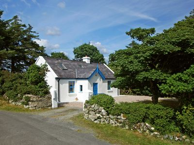 Photo for Traditional, renovated stone cottage, quiet and secluded with fine southerly views of the rugg…
