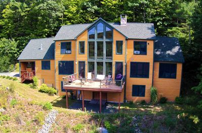 Outside view of the home, notice the huge windows and great deck!