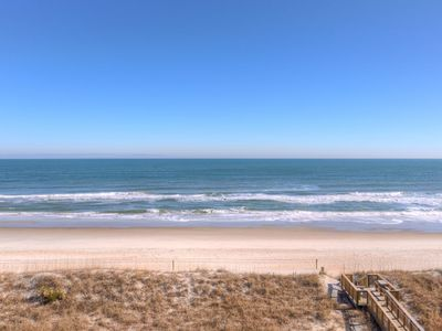 Photo for Right in the thick of Carolina Beach with awesome ocean views, steps from the boardwalk and beach!
