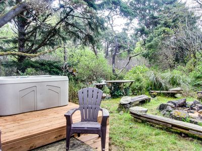 Photo for Quiet, dog-friendly home with private hot tub, backyard, & path to beach