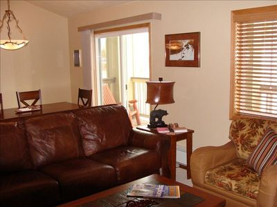 Relax in the large living area.  Very comfortable with new furniture and view.