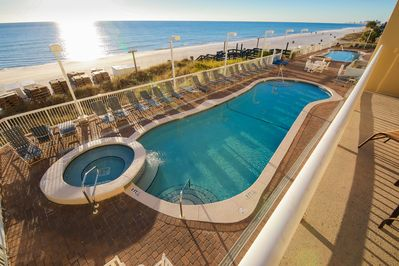 Sundeck and Two Pools with hot tubs, one on each side of the building