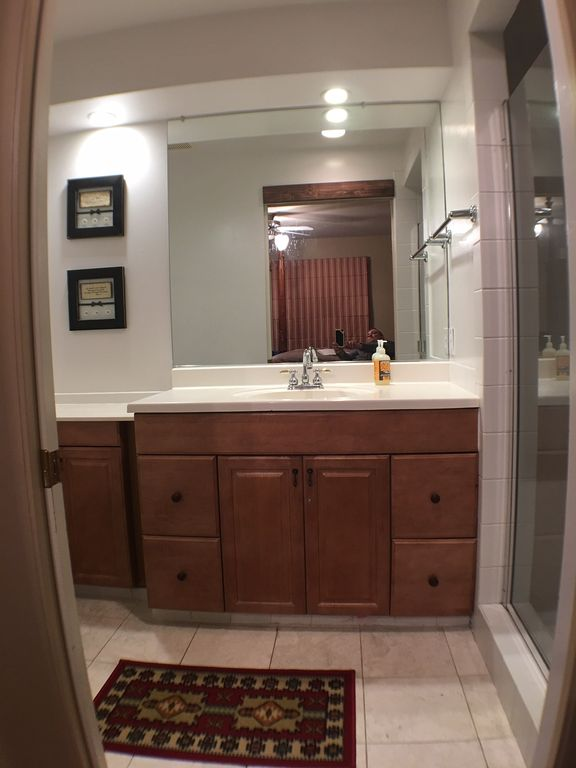 varsity theater bathroom. Cherry wood furniture  hand carved king bed Wool rug attached bathroom CASTLE option2sleep 26 VIEW Theater HomeAway Placerville
