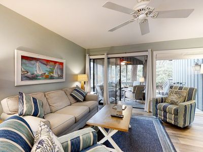 Photo for Lovely & vibrant condo w/ a screened-in porch & shared pool - close to beaches!
