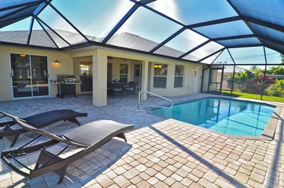 Large pool deck with lounge chairs