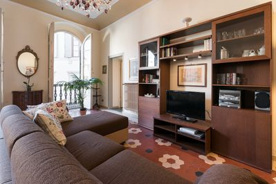Comfortable living room with satellite TV, sofa bed.
