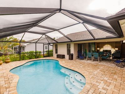 Photo for Paradise Found! SPECIALS NOW! 3 Bed 2 Bath HEATED Pool Home & Amazing Lanai Area