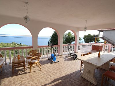 Photo for Nice aparment with big covered terrace and fantastic sea view, 300m from the sea