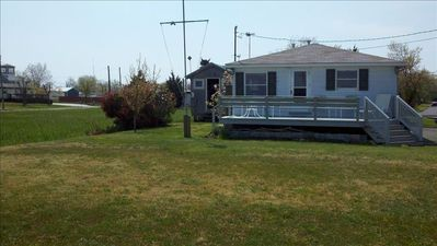 Front view of house with deck.