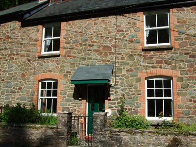 Photo for Quiet, pet-friendly cottage, easy reach of village amenities with large garden.