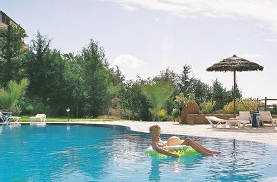 Relax in the pool & enjoy the views of the valley and coastline
