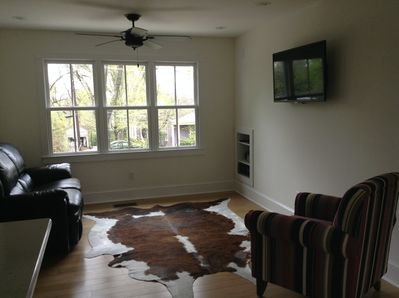 Living room area.  Lots of natural light and great view.