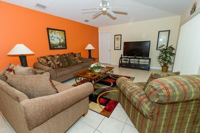 View of Family Room with entertaining center from the kitchen